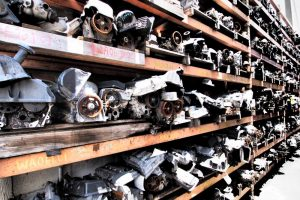 ernies-affordable-auto-parts-trucks-metal-racks-image