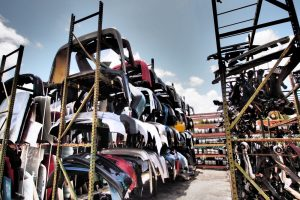 ernies-affordable-auto-parts-trucks-tall-hubcaps-racks-image